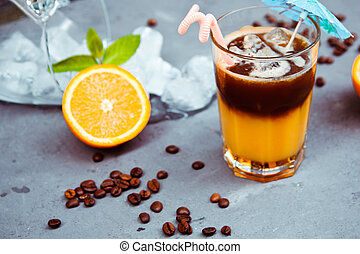 Fresh cocktail with orange, with mint and ice and coffee...