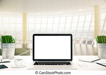 White laptop in office