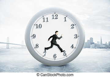 Time management concept with running businessman inside...