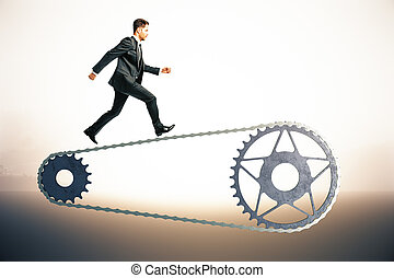Businessman on bicycle gearing - Bicycle gearing with...