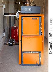 Firewood boiler in the boiler room