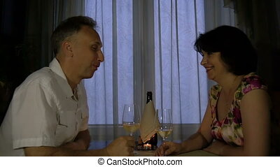 Man and woman talking at the table