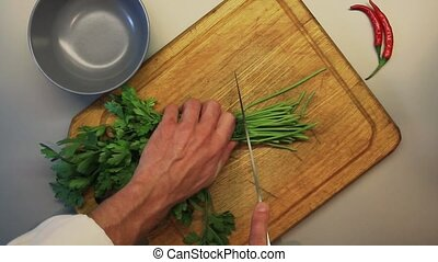 Cook chops parsley on board HD