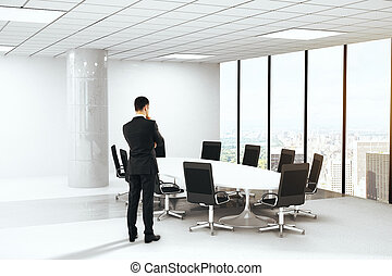 Thoughtful businessman in conference room interior with...