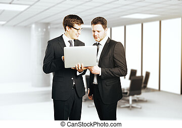 Businessmen discussing project - Young cheerful businessmen...