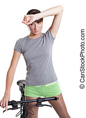 tired woman with bike