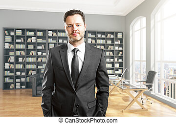 Handsome businessman in library