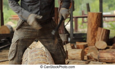profession, carpentry, woodwork concept - carpenter with ax and wood plank working at workshop