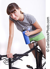 woman with bottle on bike