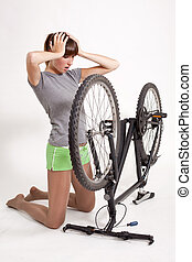 trouble with bike - woman in trouble looking at her defect...
