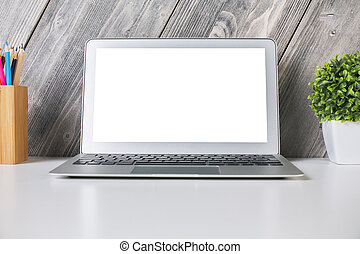 White laptop front - Closeup of laptop with white screen on...