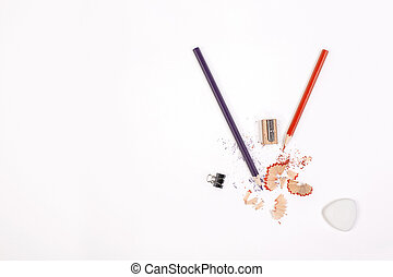 Pencil sawdust - Top view of white desktop with pencils,...
