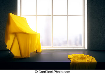 Chair under yellow cloth