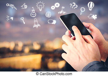 Smartphone with business icons - Businessman using...