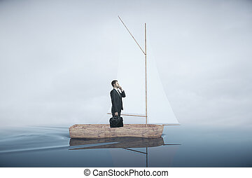 Businessman on sailing boat - Wooden sailing boat with...