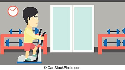 Man exercising on elliptical trainer. - An asian young man...