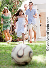 Happy family playing soccer and having fun - Happy family...
