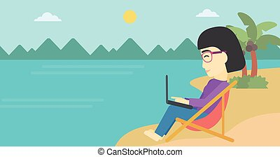 Business woman working on laptop on the beach. - An asian...