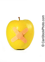 Yellow apple with strapping tape isolated on a white...
