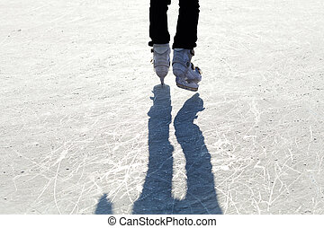 Ice Skates on the ice with shaddow