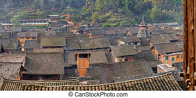 Tile roofs of wooden houses in large ancient chinese...