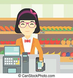 Customer paying wireless with smartphone - An asian young...