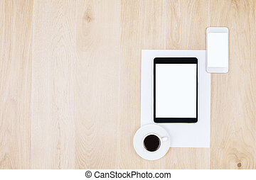Smartphone, tablet and coffee - Top view of blank white...