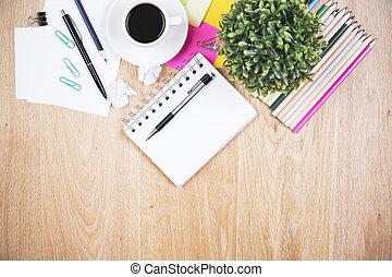 Messy office desktop - Top view of wooden office desktop...