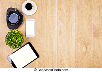 Coffee and technology - Top view of wooden desktop with...