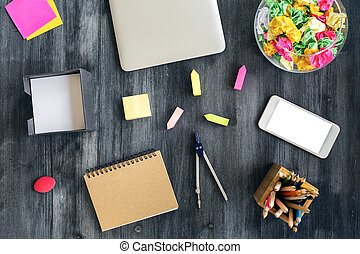 Desktop with technology and stationery - Top view of...