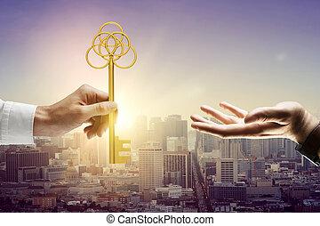 Man handing key - Man handing big golden key to another...