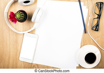 Workspace with blank paper - Top view of wooden desktop with...