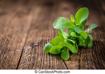 Wooden table with Stevia leaves (selective focus) - Old...
