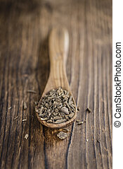 Valerian Roots on a wooden table (detailed close-up shot)