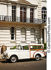 Elegant apartment building and an old car at  Notting Hill, London.