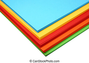 coloured paper - a pile of coloured A4 paper on white...