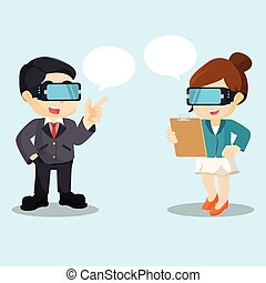 chating with virtual reality - businessman and businesswoman...