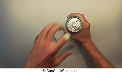 Male hand opening beer