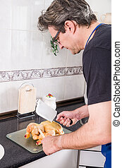 Trouble with chicken - Clueless guy trying to chop a chicken...