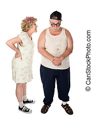 Argument - Poorly dressed couple engaged in a serious...
