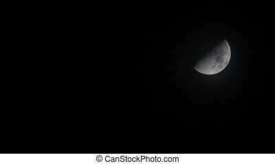 night sky with half moon on cloudy overlay