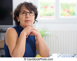 portrait of a mature woman with glasses - a portrait of a...