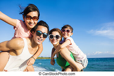 Happy Family Having Fun at the Beach