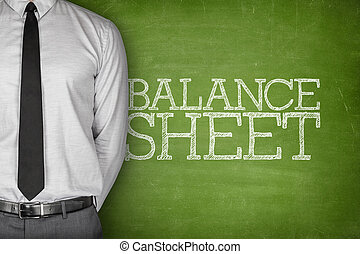 Balance sheet text on blackboard - Accounting concept on...