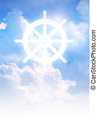 Dharma Wheel of Buddhism symbol on clouds