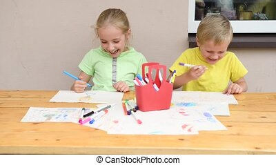 kids drawing with pencils - two kids painting with pencils
