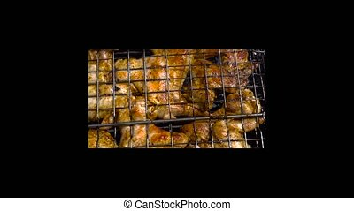 chicken wings grilling outdoors - tasty chicken wings...
