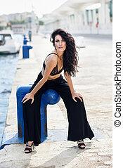 Brunette woman wearing black bra and trousers - Brunette...