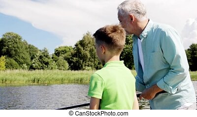 grandfather and grandson fishing on river berth 4 - family,...