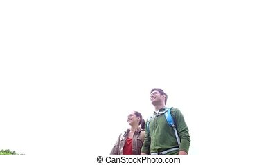 happy couple with backpacks walking outdoors 6 - travel,...